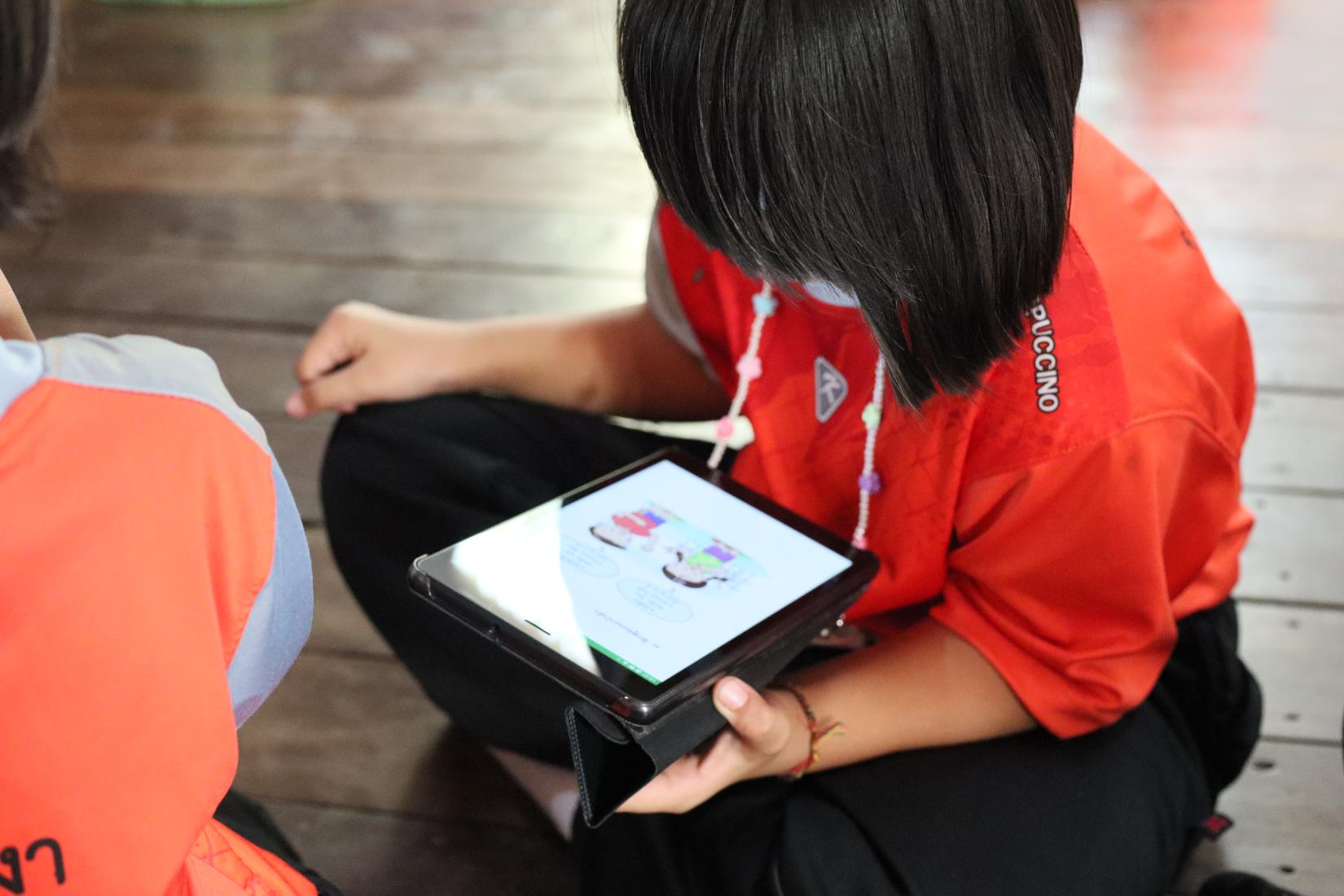A learner reads on a tablet in Mae Hong Son's Ban Mae Sa Nga School in Thailand.